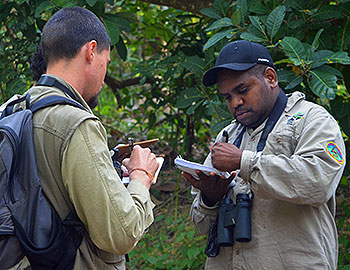 Kalan Scientist and Land Management Officer confirming field work survey notes